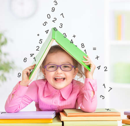 erudition: Smart kid in glasses under falling digits Stock Photo