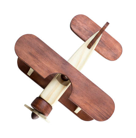 toy plane: Wooden airplane model top view isolated