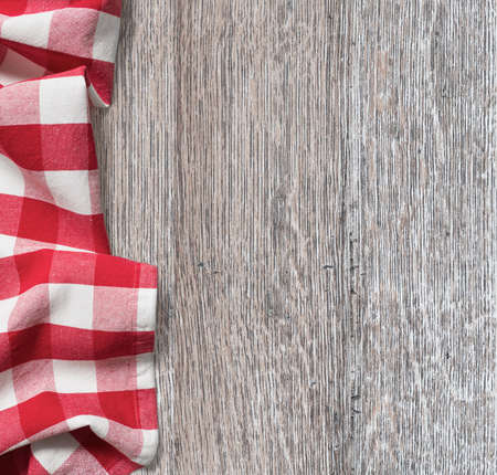 red kitchen: rough wood kitchen table with red picnic cloth background
