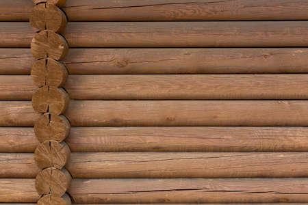 Werkholzwand aus Protokolle als Hintergrund
