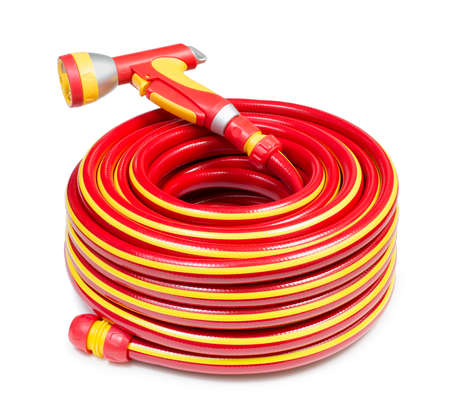 coiled: Red garden coiled hose with handle isolated Stock Photo