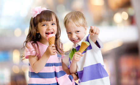 happy kids or children eating ice cream on nice bokeh background