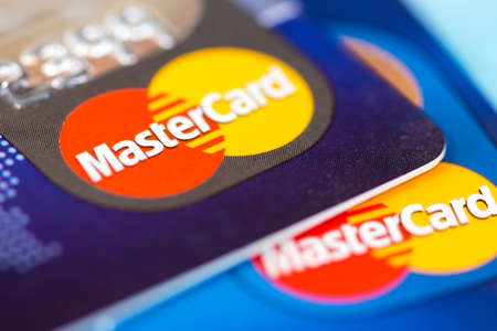 mastercard: TOMSK, RUSSIA - AUG 06, 2015: MasterCard credit cards stack. Mastercard is the one of leading the credit card companies in the world.