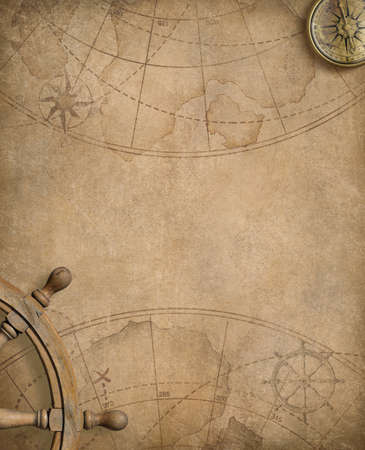 ancient paper: aged compass and steering wheel over nautical map Stock Photo