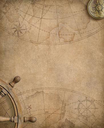 Alter Kompass und Lenkrad über Seekarte