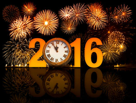 new year celebration: 2016 happy new year fireworks with old clock face Stock Photo