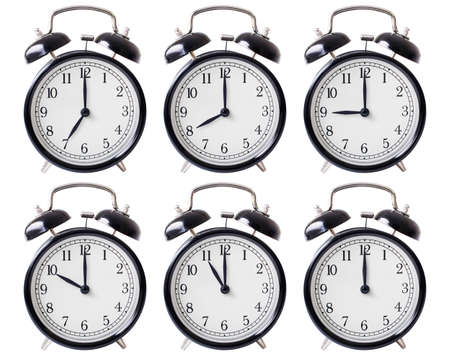12 oclock: simple alarm clock set with hands from 7 to 12 oclock isolated Stock Photo