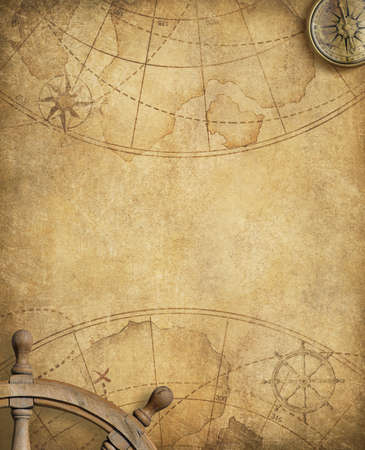 steering wheel: aged compass and steering wheel over nautical map Stock Photo