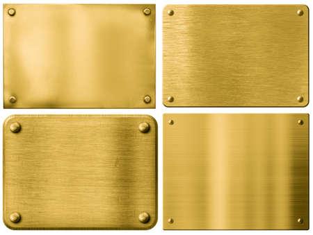 ゴールドの金属板や白で隔離リベット入り看板 写真素材