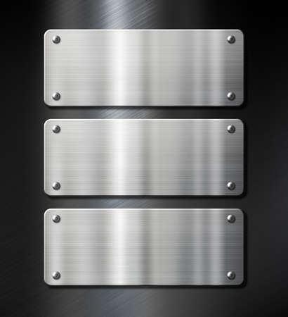 three steel metal plates on black brushed background