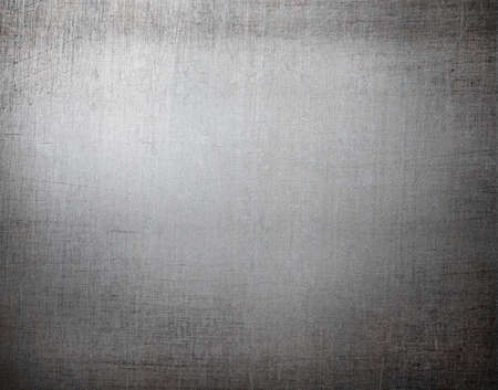 scratched: old scratched metal background or texture