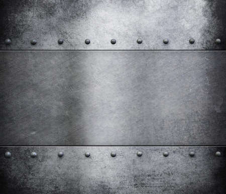 リベットの背景を持つ金属の鎧のグランジ 写真素材