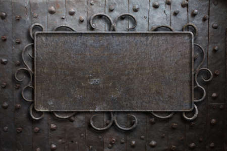 sign plate: Vintage metal sign plate on old medieval door