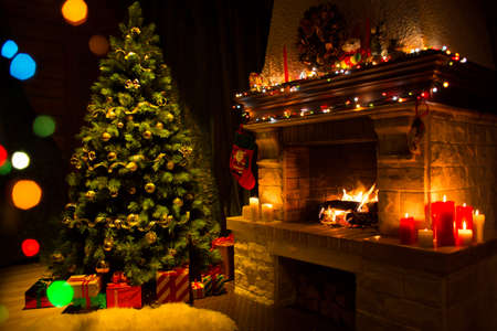christmas room: Living room with fireplace and decorated Christmas tree Stock Photo