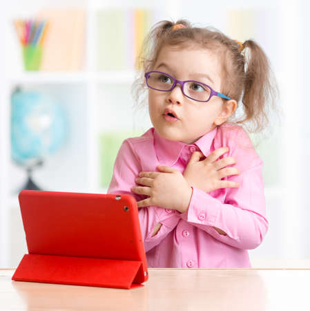 early education: Scared kid with tablet PC