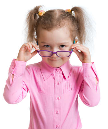 poor eyesight: Funny kid putting on glasses isolated on white