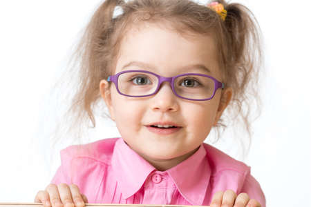 poor eyesight: Smiling girl wearing glasses closeup portrait isolated on white