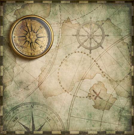 Compás de cobre amarillo y viejo mapa del tesoro Foto de archivo