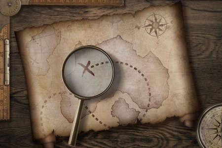 brujula: antiguo mapa del tesoro de los piratas en el escritorio de madera con el compás y la regla 3d Foto de archivo