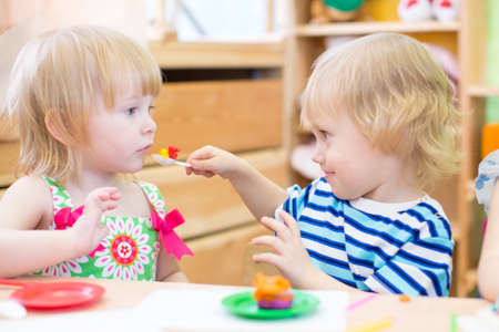 day care center: kids group playing in kindergarten together