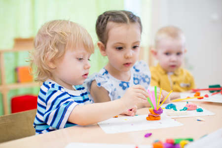 modeling: kids modeling or playing in kindergarten with interest