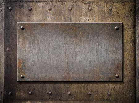 old metal plate over grunge rusty background Foto de archivo