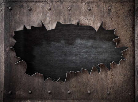 ripped metal: torn hole in rusty metal steam punk background with rivets