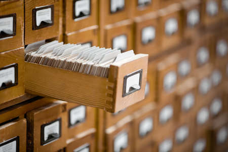reference: Old library or archive reference catalogue with one opened card drawer. Database and knowledge catalogue concept. Stock Photo