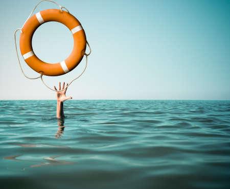 Drown man with rised hand getting lifebuoy help in sea or ocean Foto de archivo