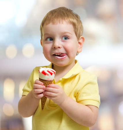 child smile: Happy child with icecream in cafe