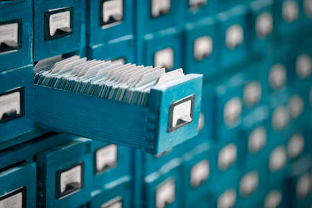 Old library or archive reference catalogue with one opened card drawer. Database and knowledge catalog concept.