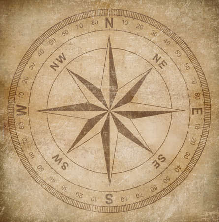 ancestry: old wind or compass rose on grunge paper background Stock Photo