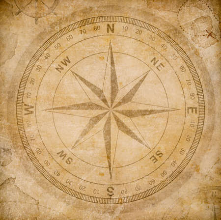 ancestry: old wind or compass rose on vintage paper background Stock Photo