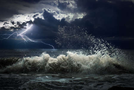 storm sea: dark ocean storm with lgihting and waves Stock Photo