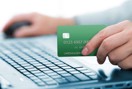 Man holding green payment card Stock Photo