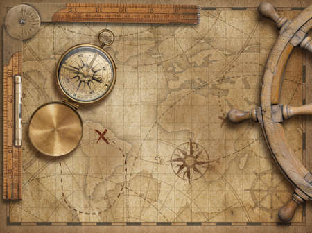 adventure and explore concept still life with old world map, ruler and steering wheel
