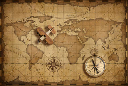 Small wood airplane over world nautical map as travel, explore and communication concept Archivio Fotografico