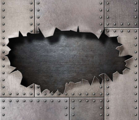 damaged metal armor with rivetsand torn hole 写真素材