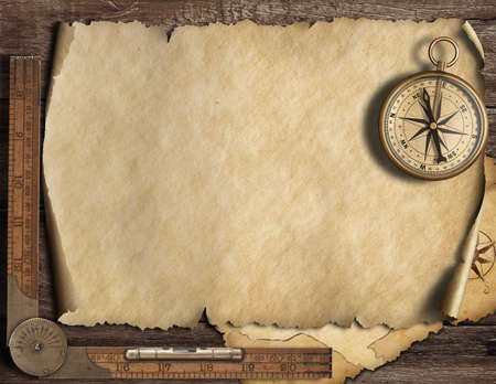 Old blank map background with compass. Adventure or discovery concept. Imagens - 75944489