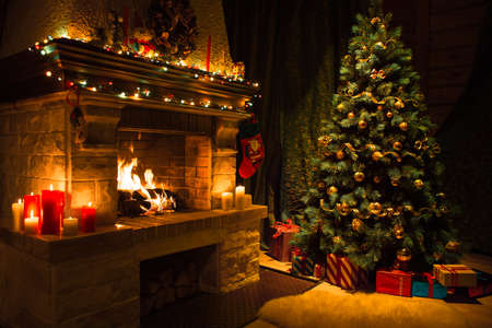 Living room interior with decorated fireplace and christmas tree