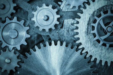 cogs and gears blue metal background