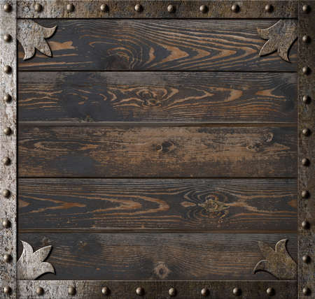 metal frame over old wooden plates background