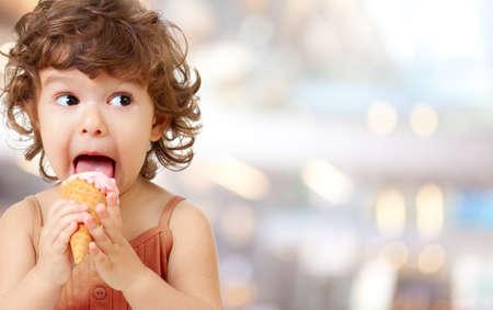 A cute small kid eating an ice cream