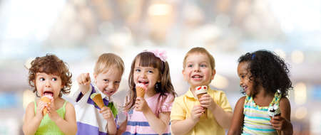 kids group eating ice cream at a party in cafe