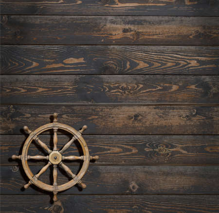 steering wheel on dark wood background