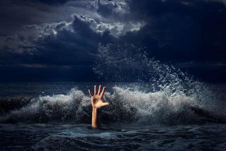drowning man hand in storm sea water Stok Fotoğraf