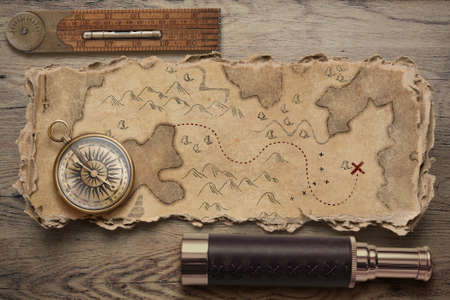 Old torn treasure map with compass and spyglass. Adventure and travel concept. 3d illustration. Standard-Bild - 116952672