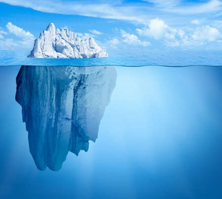 Iceberg in ocean as hidden threat concept Stock Photo