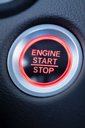 start stop car engine glowing red push button Reklamní fotografie