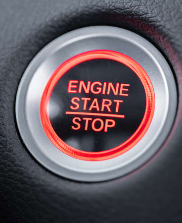 start stop car engine glowing red button